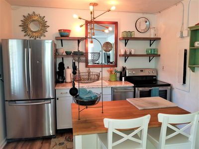 Photo for Cozy 2 bedroom, 1 bathroom w/ tub just a short walk to the beach!