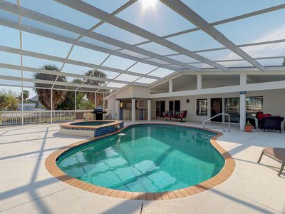 Photo for Waterfront and dog-friendly home with private pool, dock, views, and lanai!