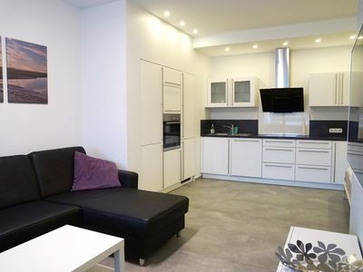 Photo for First-class apartment on the beach, swimming pool and sauna in the house, for up to 4 people