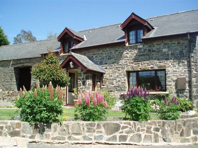 Photo for Friendly Cottage is a lovely detached stone property in the quiet and historic part of Llanarth, abo