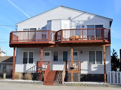 Photo for STEPS TO THE BEACH!!!! Washer/dryer, dishwasher, microwave, coffee maker, toaster, and gas grill, DVD Player, Outside Shower. 2 Decks with furniture. Central air, off street parking.