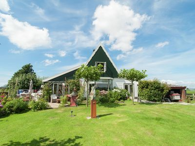 Photo for Spend your holidays in a luxury miller's home right next to Holland's oldest windmill