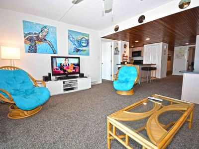 Photo for Unique and stylish 2 bedroom oceanfront condo with WiFi, an outdoor pool, and an enclosed porch with ocean views located uptown just steps to the beach!