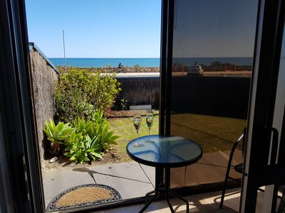 Looking from the lounge room to the beach, across the enclosed garden