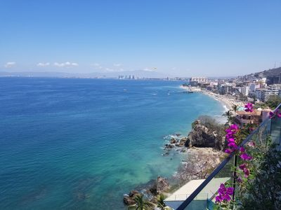 Sweeping panoramic blue ocean and Banderas Bay  view from terrace