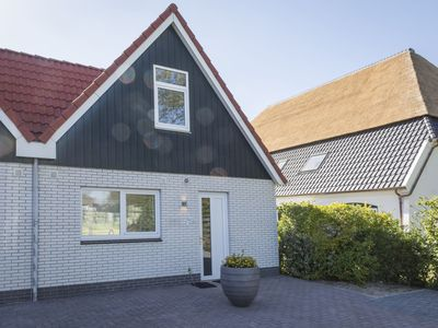 Photo for Semi-detached holiday home with a view in De Cocksdorp, on the island of Texel