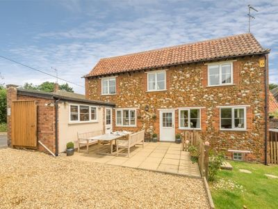 Photo for An immaculately presented, detached three-bedroom family holiday home.