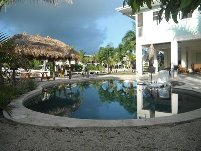 Photo for gated 1/2 acre lot / lagoon pool/ 175 ' dock, best ocean/gulf acess in Keys