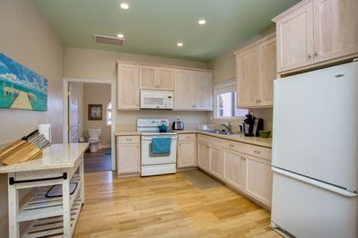 Very spacious kitchen, with quartz counter tops, fully stocked with every utensil, and a variety of spices, pots, pans, full-size refrigerator/freezer.