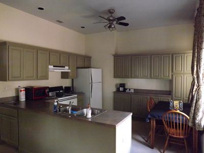 Kitchen with all appliances, dishes, cooking items.