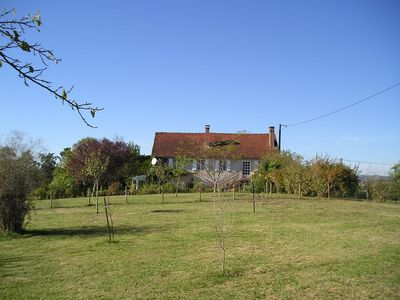 Photo for Delightfully restored country property, splendid views near Dordogne/Lot borders
