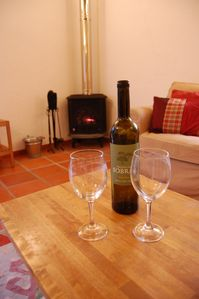 Enjoy a glass of wine in the warmth of the stove