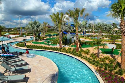 AMAZING resort club with pools, water slides, lazy river, bar and kids area.