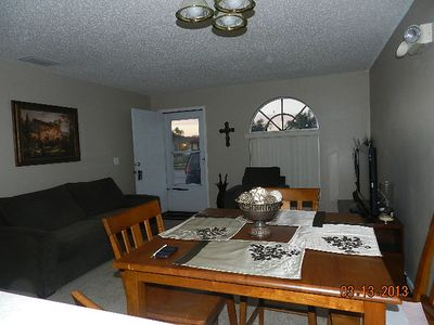 Comfortable living/dining area with sofa sleeper and flat screen TV