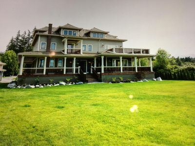 Photo for Beautiful home on the water with spectacular views of water and mountains