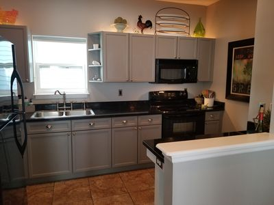 Well Equipped Main floor kitchen. All cooking + serving items available.