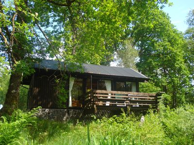 Photo for Strae is a Charming Log Cabin, Deep in the Forest, by a Babbling Burn.
