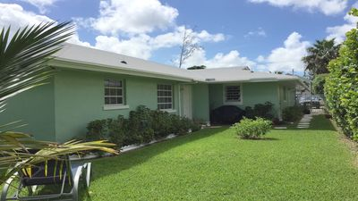 2 Bedroom Spacious Apt. enclosed backyard with patio walking distance to beach