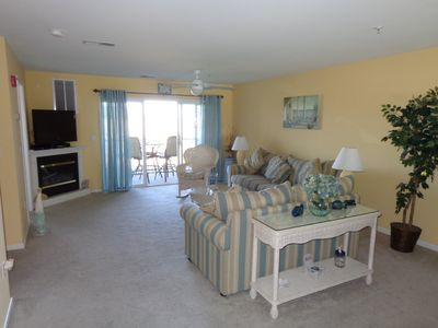spacious living room with queen sleeper sofa and screened porch