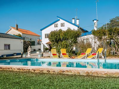 Photo for This 12-bedroom villa for up to 24 guests is located in Ericeira and has a private swimming pool....