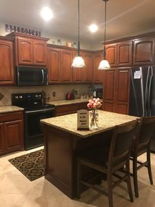 Full size kitchen with refrigerator/freezer, stove, microwave & coffeemaker
