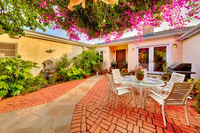 Dining or grabbing a snack al fresco in the front courtyard garden can be an every day treat!