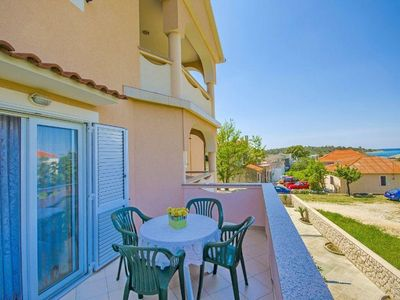 Photo for Two bedroom apartment with terrace and sea view Novalja, Pag (A-17000-a)