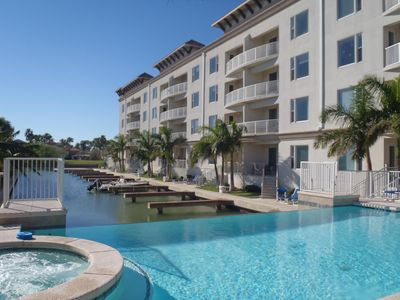 Ground floor condo on the Channel! Infinity Pool & Hot Tub! Boat Slip Included! Close to Clayton's!