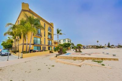 """Ground floor condo with outdoor patio located right next to the Mission Beach Boardwalk. Scenic views of beach and bay.  """"Everything was spectacular. The condo has more than enough room and the location is fantastic."""" - David (guest)"""