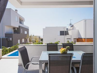 Photo for Two bedroom apartment with terrace and sea view Novalja (Pag)