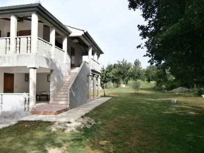 Photo for Apartment in holiday home with private pool,  garden with grill, airco and wifi