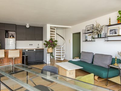 Photo for Outstanding 2BR with double-height ceilings, mins from the Catacombes, by Veeve