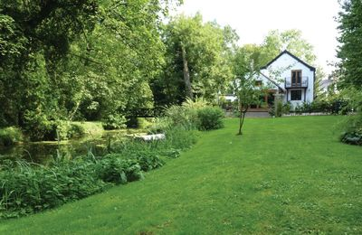 Photo for Riverside Cottage is the end terrace of a converted watermill on the banks of the River Waveney.