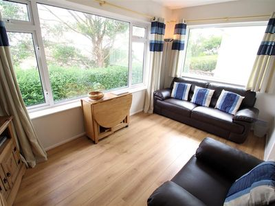 Photo for This cosy coastal chalet is in Limeslade, a great family destination with its lovely sandy beaches,