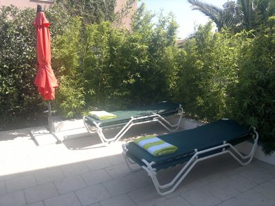 Sun lounge with four Vlaemynck sun loungers; all beach linens are provided