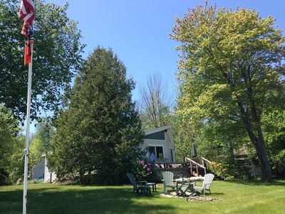 The cottage is snuggled within the trees.  This is a view from the lake.