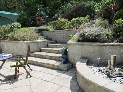 Steps to the lawn and woodland bank
