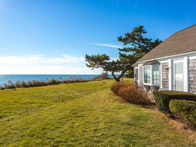 Photo for NEW LISTING! Charming waterfront cottage w/fireplace, full kitchen-walk to beach