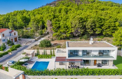 Photo for NEW: Modern 4 bedroom villa near the beach with pool and jacuzzi