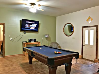 "Game room with pool table and 65"" flat screen tv"