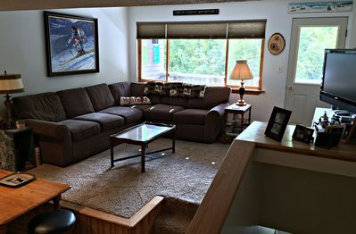 Living room showing deck and spacious seating.