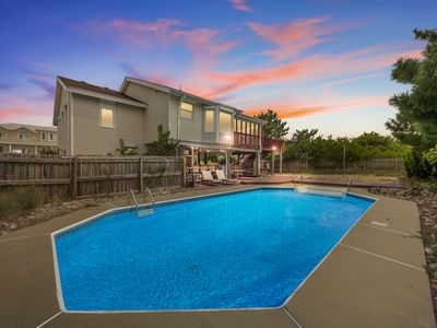 Just steps to the beach with a pool, 5 bedrooms, 3 baths, sleeps 14