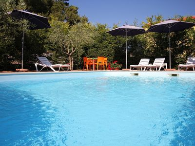 Photo for Spacious apartment with pool, 3 bedrooms, air conditioning, WiFi, BBQ and great outside terrace