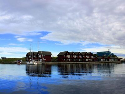 Photo for Apartment on the waterfront for 4 persons incl. 50 hp boat