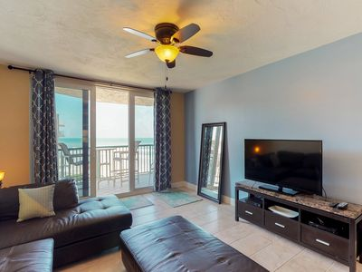 Photo for Condo w/ private balcony, shared pool/hot tub & ocean views - walk to beach!