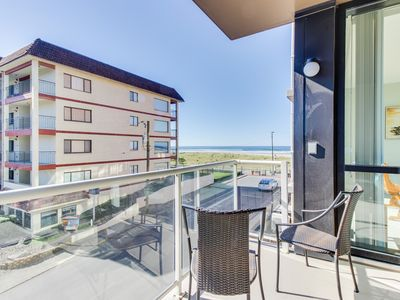 Photo for Beautiful contemporary condo w/ ocean views, shared pool, & sauna at Sand & Sea!