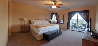 The Master Suite, complete with a pillow-top king size bed and flat-screen TV.