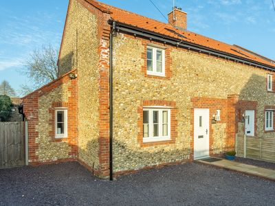 Photo for An attractive and beautifully furnished flint and brick cottage on a quiet lane.
