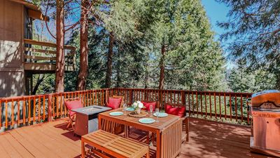 Large spacious deck includes fire pit, outdoor dining, and BBQ. - Large spacious deck includes fire pit, outdoor dining, and BBQ.