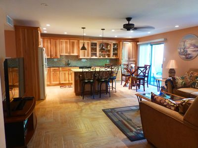 Nice open floor plan w/functional and fully stocked kitchen.